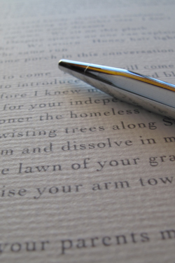image of bespoke poem with pen
